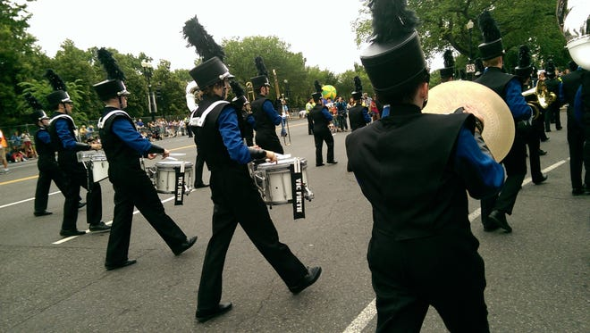 Percussionists keep the beat as Havre High School's marching band took part in the Independence Day Parade on Monday in Washington, D.C.