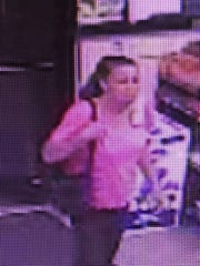 Authorities are searching for a woman they say robbed a senior citizen at a gas station on Thursday.