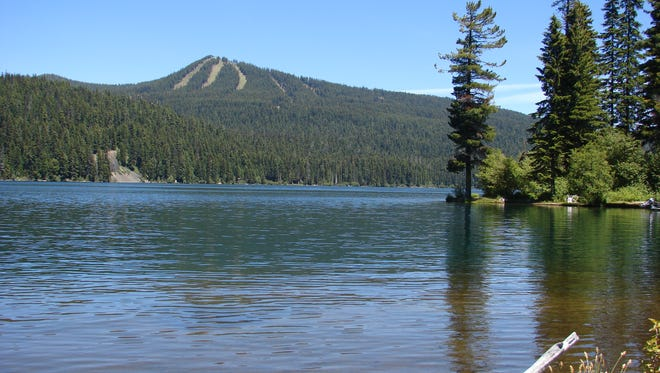 Odell Lake is under a health advisory to avoid water contact because of a bloom of toxin-producing blue-green algae.