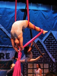 Macee Holshouser performing on the aerial silks in