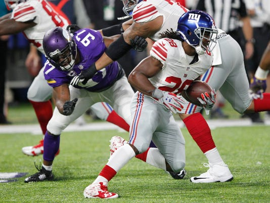 New York Giants running back Paul Perkins (28) runs from Minnesota Vikings defensive end Everson Griffen (97) during the first half of an NFL football game, Monday, Oct. 3, 2016, in Minneapolis. (AP Photo/Andy Clayton-King)