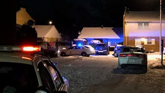 Police lights illuminated an east side neighborhood where a man was found shot dead in a car on Monday night. Another man, wounded several times, walked up to police a few blocks away.
