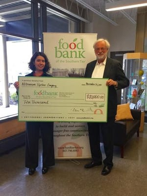 Food Bank of the Southern Tier President and CEO Natasha Thompson and Michael Armiak, community affairs consultant for Millennium Pipeline Company pose with an oversized check