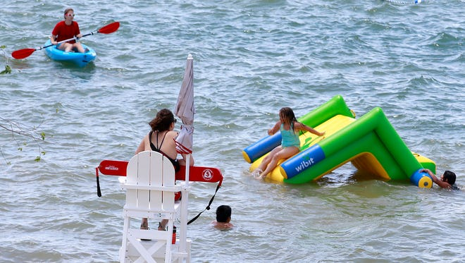 Lifeguard supervisor Lauri Roberts-Nutt keeps an eye on swimmers on May 27 during the opening day for the designated swimming area at Farmington Lake.
