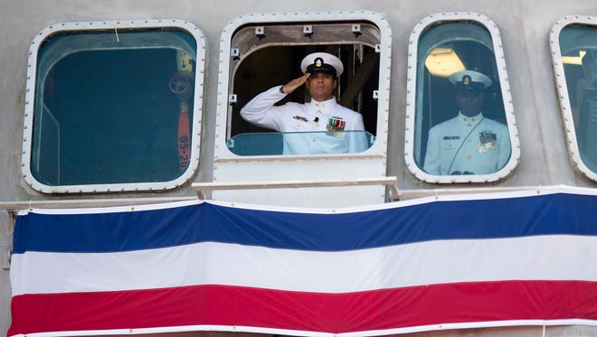 Quarter Master Miguel Rosinski salutes during the Commissioning of the USS Montgomery (LCS 8) in Mobile, Ala., on Saturday, Sept. 10, 2016.