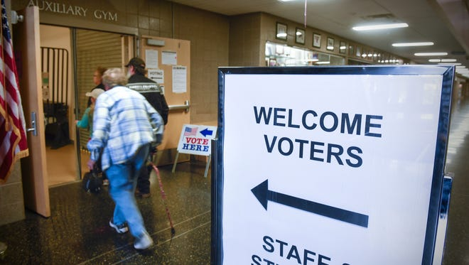 Voters make their way to the polls Tuesday, May 23, at Sauk Rapids-Rice High School in Sauk Rapids.