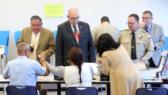 El Pasoans line up during early voting May 15 at the El Paso County Sheriff's Office Headquarters. Tuesday is election day in the runoffs.
