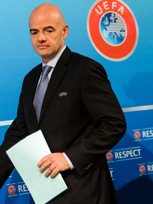 UEFA General Secretary Gianni Infantino arrives for a press conference after the meeting of the UEFA Executive Committee and the meeting of UEFA's 54 member associations, at the UEFA Headquarters, in Nyon, Switzerland, Thursday, Oct. 15, 2015. All 54 European soccer nations decided Thursday to back Michel Platini while the UEFA president is still fighting to clear his name. (Jean-Christophe Bott, Keystone via AP)