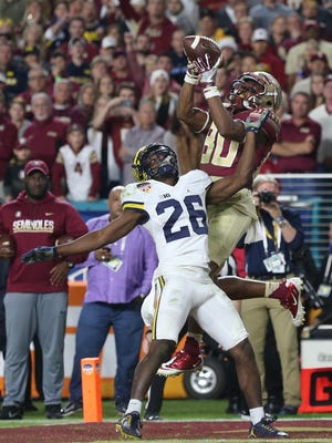 Florida State receiver Nyqwan Murray catches the go-ahead touchdown in the fourth quarter against Michigan's Jourdan Lewis in Friday's Orange Bowl at Hard Rock Stadium.