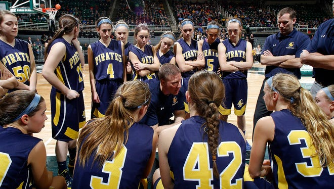Pewamo-Westphalia coach Steve Eklund talks to his players during a timeout against Detroit Edison in their MHSAA Class C championship game, Saturday, March 18, 2017, in East Lansing, Mich. P-W fell 46-44.