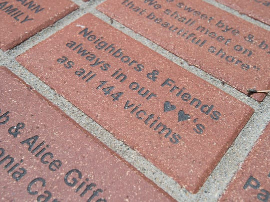 Bricks serve as a memory of the victims in the 1976 flood of the Big Thompson River in Drake.