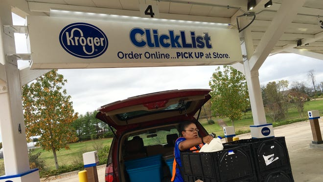 Gallatin Kroger Marketplace ClickList associate Jonish Moore loads groceries Tuesday ordered online through the company's website.