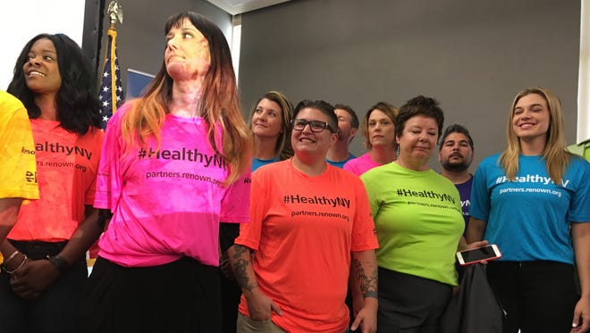 Participants stand during a 2016 press conference for the Healthy Nevada Project .
