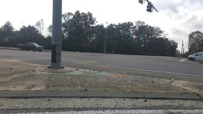 Glass and other debris remain  at the scene of a fatal car wreck at Monroe Road and Evelyn Gandy Parkway.