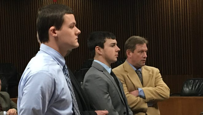 Michael Roth, 18, and Tanner Coolsaet, 19, of Grosse Ile appear Wednesday Jan. 11, 2016 in Wayne County Circuit Court for sentencing in the killing/torturing of a Guinea pig last April. They're pictured here with attorney Edward Holmberg, right.