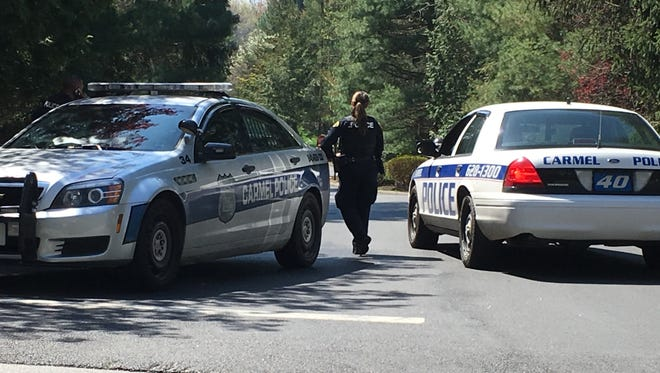 Carmel police block Nottingham Way in Mahopac, near the entrance to Coventry Circle, where a homicide investigation is taking place, Friday, April 28, 2017.