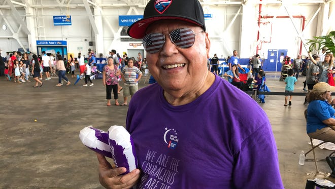 """Yona resident Manny Cruz cools off after his team successfully completed the first round at the United Airlines """"Tow the Line to Save Lives"""" 12th Annual Plane Pull in Tiyan on Saturday, June 24."""