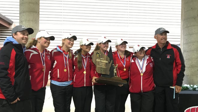 The Arrowhead girls golf team received its championship trophy after winning the Division 1 state title Oct. 10. Members of the team are (from left) assistant coach Ryan Andrews, Ellie Kaiser, Caroline Kroeninger, Gianna Gastrow, Sarah Ernst, Emily Lauterbach, Skyler Phillips and head coach Mike Breaker.