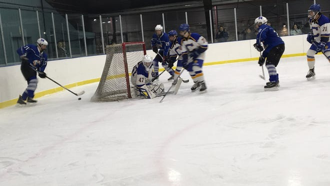 Charles Palmer (left) is behind the net looking for line mates Spencer Brown (center) and Sam Charlat (right).
