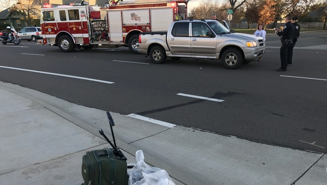 Redding police get details after a pickup hit a woman who was crossing the middle of Old Alturas Road at Bradford Way with luggage. The woman was taken to a hospital by ambulance following the 3:40 p.m. collision.