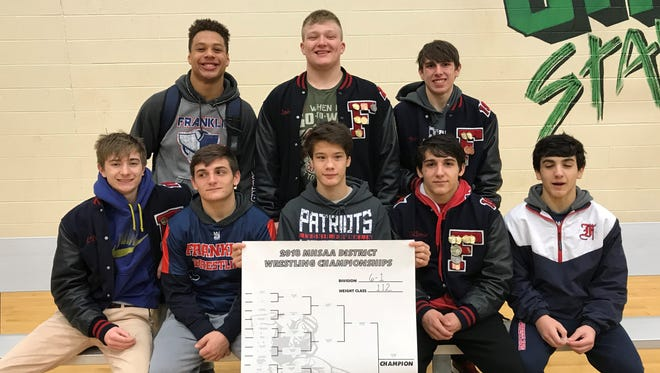 These eight Livonia Franklin wrestlers finished in the top four at Division 1 individual districts at Novi, thus qualifying for D1 individual regionals Feb. 17 at Saline. In the front row (from left) are Howie Whitaker, Johnny DiPonio, Russ Rusnell, Marino DiPonio and Rocco DiPonio. In the back row (from left) are Manee Willie, Jake Swirple and Logan Evanchuk.  Front row - Howie Whitaker, Johnny DiPonio, Russ Rusnell, Marino DiPonio, Rocco Diponio  a