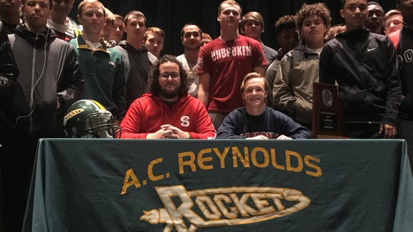 Reynolds lineman Jake Setterlind (NC State) and punter Sidney Shoop (Arizona) were honored Thursday at the high school