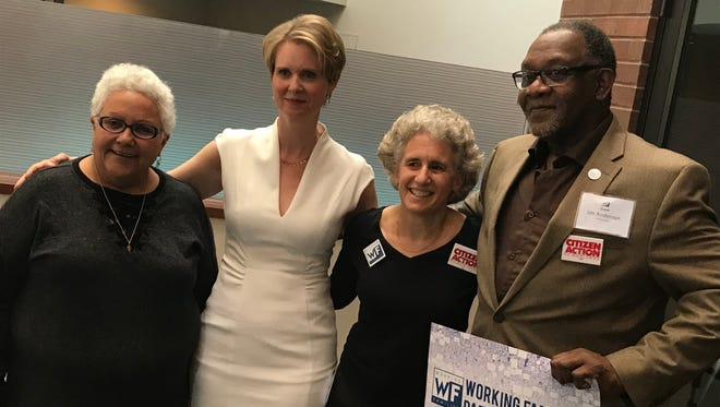Cynthia Nixon, second from left, poses for photos with members of the Working Families Party, including co-chair Karen Scharff, second from right, after securing the party's endorsement Saturday at the Albany Hilton.
