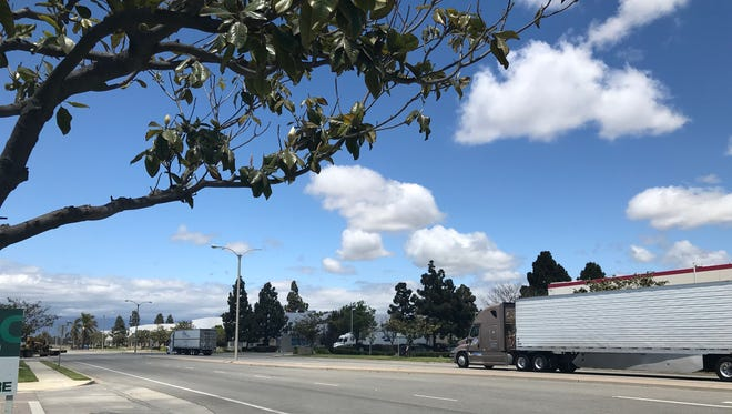 A semitrailer travels along Del Norte Boulevard in Oxnard. A federal program is providing tax incentives for investment in the eastern portion of the city.