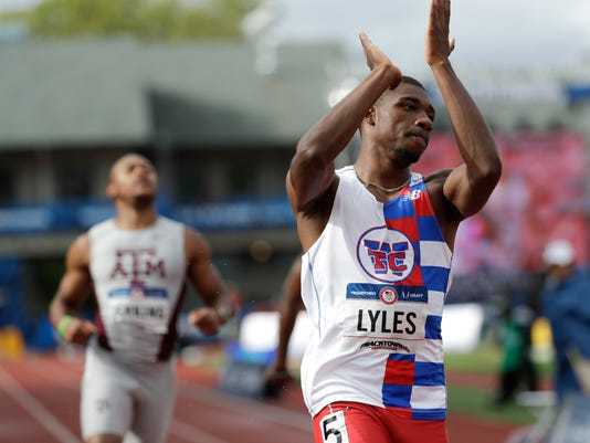 Noah Lyles celebrates after winning his heat during the semifinals in the men's 200-meter run at the U.S. Olympic Track and Field Trials, Friday, July 8, 2016, in Eugene Ore. (AP Photo/Marcio Jose Sanchez)