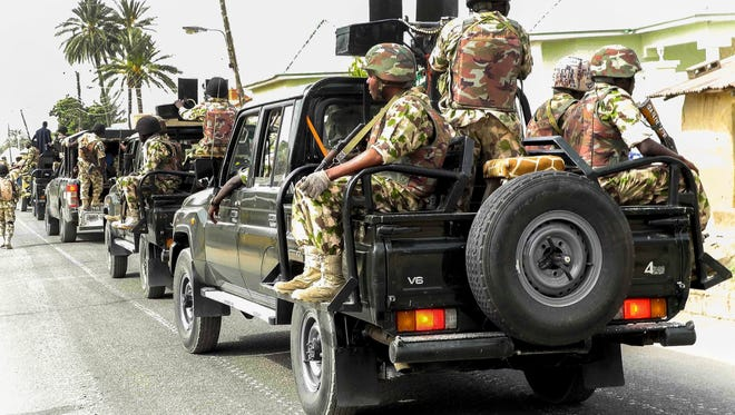 The Nigerian military patrols after flushing out Boko Haram Islamic militants from Michika, Nigeria, on March 19, 2015.