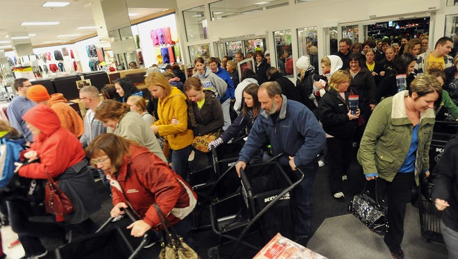 Shoppers race through the front doors of Kohl's on South Louise Avenue for Black Friday deals.