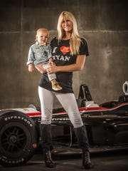 Beccy Hunter-Reay, wife of Ryan Hunter-Reay, poses with with her son Ryden.