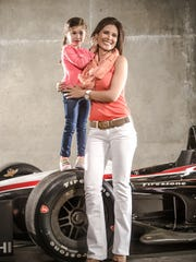 Adriana Henao, significant other of Helio Castroneves, and their daughter Mikaella.