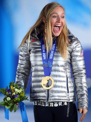 Jamie Anderson (USA) reacts after receiving her gold medal in the medal ceremony for the ladies' snowboard slopestyle during the Sochi 2014 Olympic Winter Games at Medals Plaza.