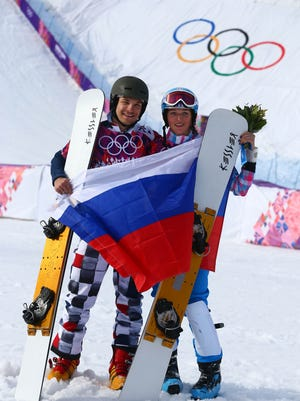 Vic Wild (RUS, left) wins gold in the men's parallel giant slalom and his wife Alena Zavarzina (RUS) wins bronze in the women's parallel giant slalom during the Sochi 2014 Olympic Winter Games at Rosa Khutor Extreme Park on Wednesday.