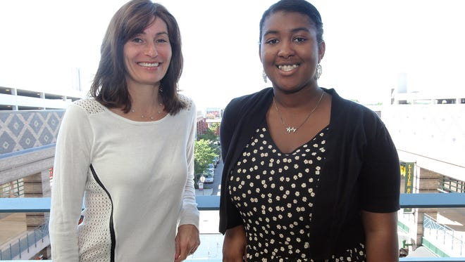 Kiana Lucas, 14, right, is photographed with her mentor Anita Borkenstein before an end of the year celebration at Showcase Cinema de Lux at Ridge Hill in Yonkers June 7, 2014.  In the fall Yonkers Partners in Education lined up 70 community volunteers to act as mentors an coaches to Yonkers High School students for the school year.