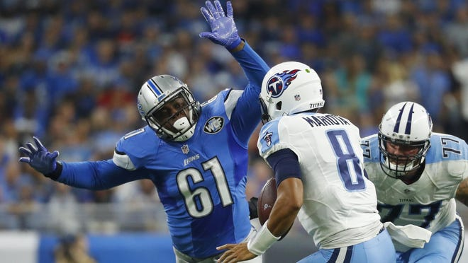 Lions defensive end Kerry Hyder chases Tennessee quarterback Marcus Mariota earlier this season.