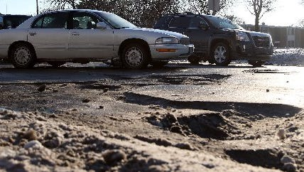 Road funding talks are at an impasse and may be suspended indefinitely, Gov. Rick Snyder said Tuesday after meeting behind closed doors for more than an hour with the four legislative leaders from both parties.