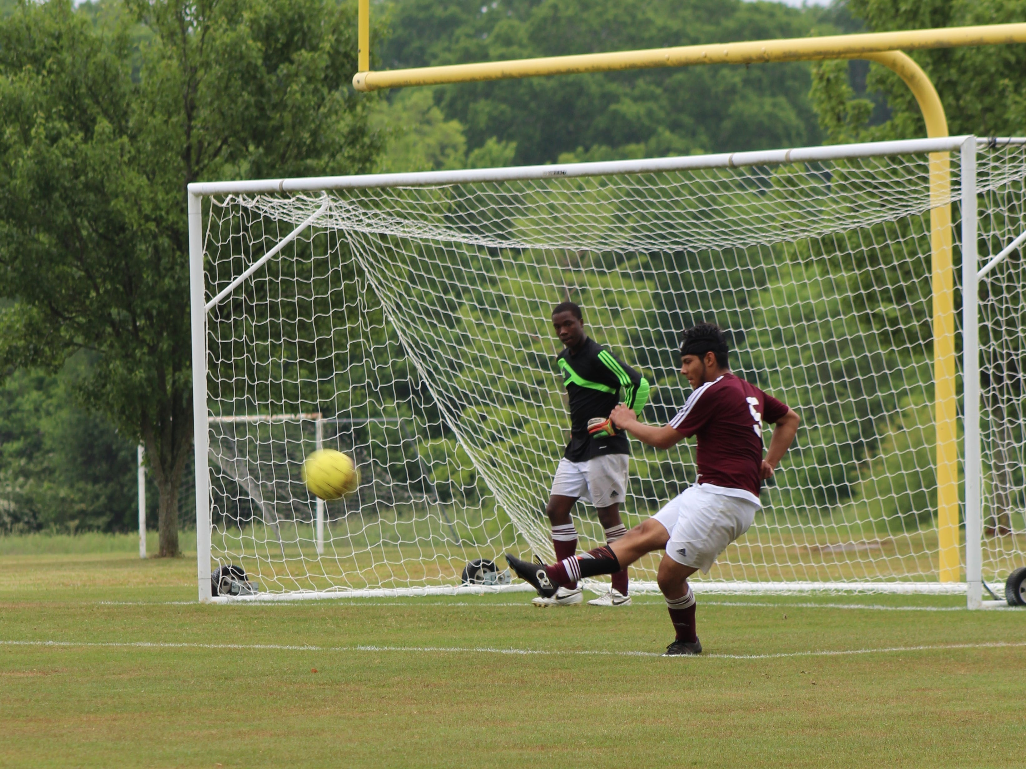 Sacred Heart's Christian Nava clears the ball against Webb School of Bell Buckle in a sub-state match.