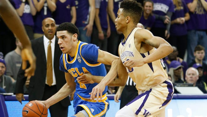 UCLA's Lonzo Ball drives on UW guard Markelle Fultz in the first half Saturday. Fultz had 25 points, six rebounds and five assists and Ball had 22 points, six rebounds and five assists in the matchup of the freshmen guards who are considered the top two prospects for this summer's NBA draft. Ball had plenty of help, though, as the No. 11 Bruins won 107-66 in Seattle.