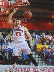 USD's Tyler Flack (23) dunks the ball during a South