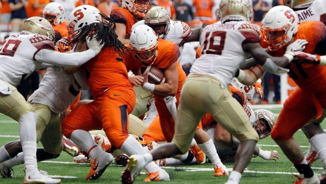 Syracuse's Tommy DeVito, center, runs for a touchdown in the third quarter of an NCAA college football game against Florida State in Syracuse, N.Y., Saturday, Sept. 15, 2018. (AP Photo/Nick Lisi)