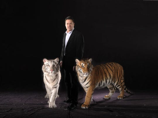 Illusionist Jay Owenhouse and his pair of Bengal tigers