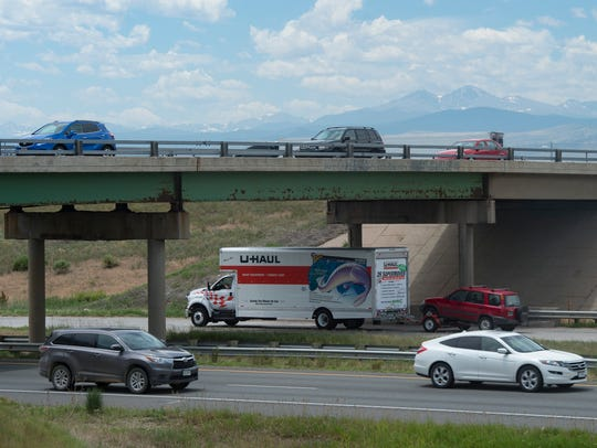 Traffic flows on I-25 under the Prospect Road bridge