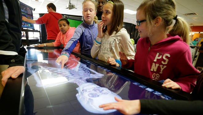 Students look at an interactive display of the human skeleton during the Michigan Tech Mind Trekkers event that drew 2,000 middle school students to NWTC to participate in displays of science, technology, engineering and math.