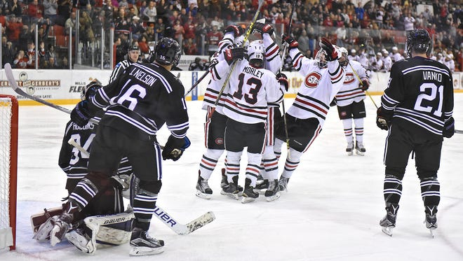 St. Cloud State players celebrate a goal at the Herb Brooks National Hockey Center.