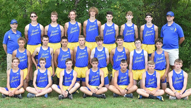 Members of the 2020 East Canton boys cross country team are (front row, left to right) Braxton Ohman, Nathanael Martin, Connor Groghan, Matthew Bellamy, Brian Strunk, Noah Collins and Alex Yarian; (second row) Lucas McCauley, Kyle Crable, Anthony Cilona, Bode Menegay, Levi Nelson, Landen Demos, Luke Buxton and Brylan Holland; and (back row) Head Coach Lee Sternberg, Andrew Wade, Brett Buxton, Gabe Shilling, Caleb Shilling, Joey Bellamy, Jonathan Randulic, Nick Martino and Coach Jason Wade.