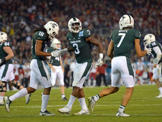 Michigan State Spartans running back LJ Scott (3) is congratulated after scoring a touchdown during the second quarter against the Washington State Cougars in the 2017 Holiday Bowl at SDCCU Stadium.