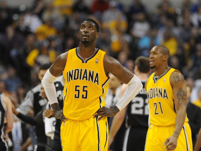 Indiana's Roy Hibbert looks up at the scoreboard in the third quarter as the San Antonio Spurs beat the Indiana Pacers 103-77 at Bankers Life Fieldhouse Monday March 31, 2014.