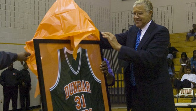 .Walter Wesley, Dunbar High School Class of 1962, played for the Cleveland Cavaliers. He's shown here getting his retired jersey from Dunbar High.